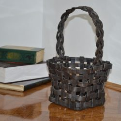 wrought iron basket will give your home nice décor and a warm and pleasant feel